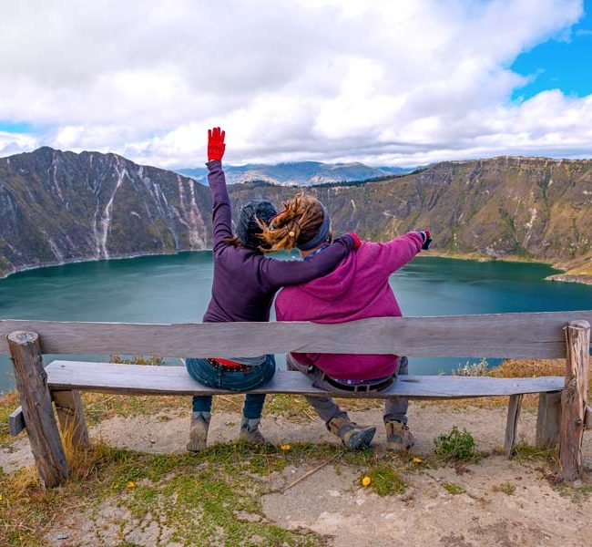 couple enjoying a lake view in ecuador quilotoa 2021