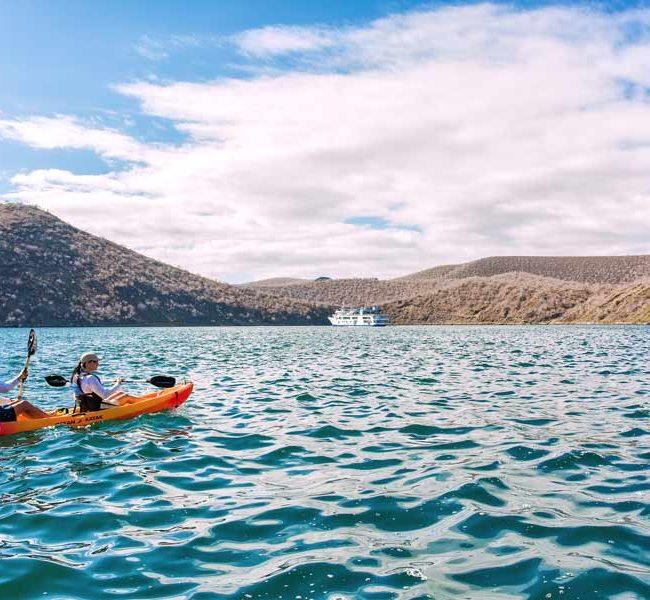 kayaking outside the Isabela II cruise yacht