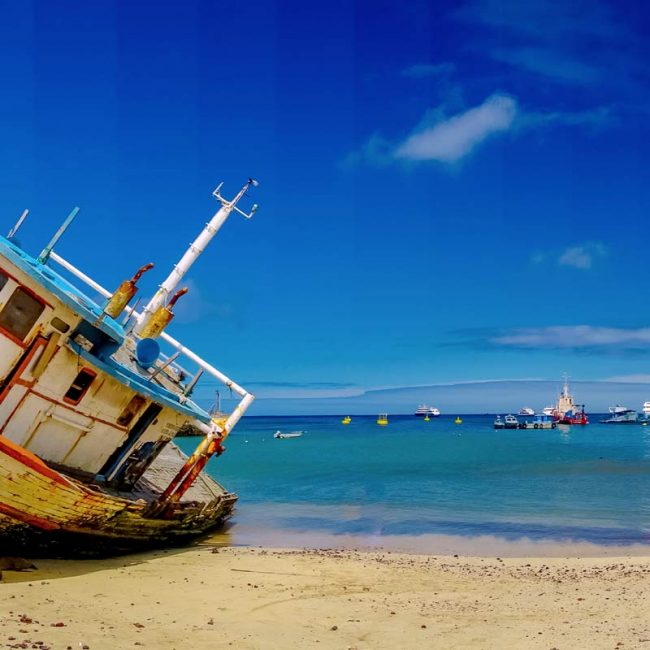 abandoned ship in the beach of galapagos