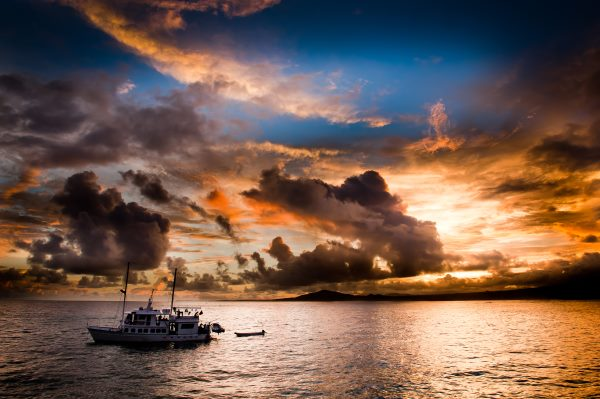 sunset in galapagos with cruise